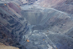 Iron ore opencast mining. Quarry with lots of machinery at work - view from above Stock Image