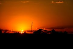 Iron Ore processing plant at sunset Stock Photos