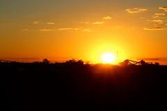 Iron Ore processing plant at sunset Stock Photo