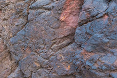 Iron ore texture closeup - natural minerals in the mine. Stone texture of open pit. Extraction of minerals for heavy Royalty Free Stock Photos