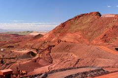Iron Ore Truck Unloading, Conveyor and Stockpile in the Hamersley Ranges Stock Photo