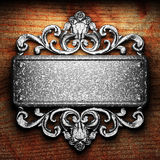 Iron ornament on wood Stock Images