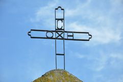 Iron Orthodox Cross with blue sky in background. Southeast Serbia stock images