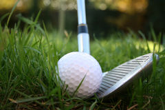 Iron out of the rough 1. Iron about to hit a golf ball from the rough - low angle shot Royalty Free Stock Photo