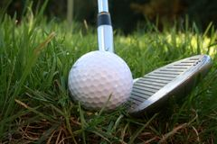 Iron out of the rough 3. Iron about to hit a golf ball from the rough - low angle shot Royalty Free Stock Images