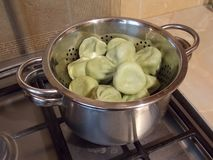 Iron pan with delicious dumplings stock images