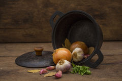 Iron pan with flavoring ingredients Stock Photos