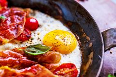 Iron pans and bacon eggs heathy breakfast stock images