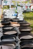 Iron pans on table Stock Image
