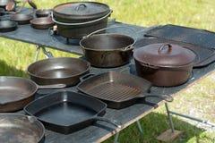 Iron pans on table Royalty Free Stock Photos