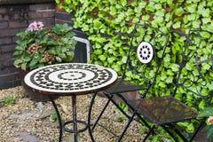 Iron patio furniture Royalty Free Stock Photo
