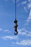 A iron pendulum hook with blue sky. Stock Images