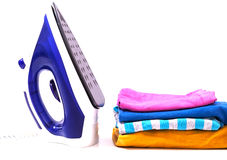 Iron and pile of clothes Royalty Free Stock Image