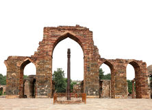 Iron Pillar and arches with intricate design in Qutub Minar Complex Stock Image