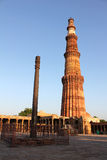 Iron pillar with qutub minar Royalty Free Stock Image