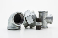 Iron pipe fittings for plumbing. Royalty Free Stock Photo