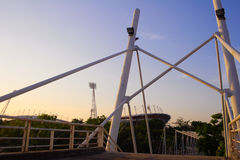 Iron pipe line bridge and a stadium background. Also had a clear sky in twilight Stock Photography