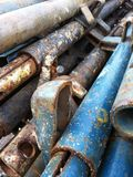 Iron pipes in construction site. Blue and rusty iron pipes in construction site Royalty Free Stock Photos