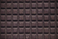 Iron plate with a checkered pattern. Iron plate with a checkered pattern slightly rusty located on a whole space of picture. Suitable background  for pictures Stock Photography
