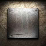 Iron plate on wall Royalty Free Stock Photography