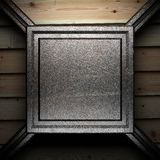 Iron plate on wall Royalty Free Stock Photo