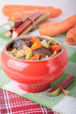 Iron pot with baked chicken liver, carrots and rhubarb Royalty Free Stock Photo