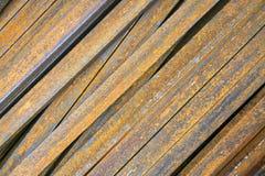 The iron profile lies diagonally. Texture of iron rusty sticks, lie diagonally royalty free stock photography