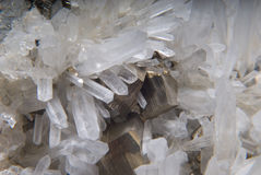 Iron pyrite and quartz crystals and granite Royalty Free Stock Photo
