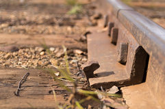 Iron rail. Old railway track with rusty nail stock photography
