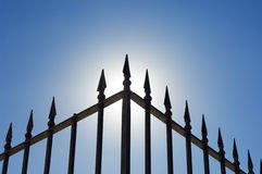 Iron railing. Edge of an old spiked iron railing against the shinning sun Stock Photography