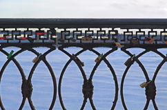 Iron railing in the park. Fence embankment covered with snow Stock Images