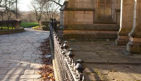 Church and Railings made of stone. The iron railings alone the stone church Royalty Free Stock Images