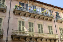 Iron railings on balconies ofold houses at Sassello, Italy Royalty Free Stock Photos