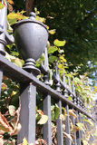 Iron railings bordering a London garden square in Autumn Stock Image