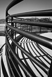 Iron railings on a curved path. Curved path to the beach with wrought iron railings creating shadows Stock Photos