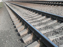 Iron rails. Railway. Iron rails that converge in the distance. Close-up Royalty Free Stock Photos