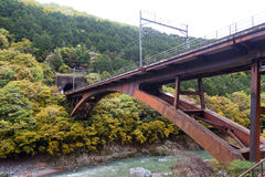 Iron railway bridge over Hozu River in Arashiyama, Japan Royalty Free Stock Photos