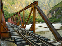 Iron railway bridge over Urubamba river near Machu Picchu Stock Image
