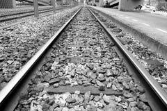 iron railway over dark stone Royalty Free Stock Image