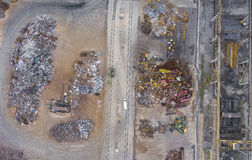 Iron raw materials recycling pile, work machines. Metal waste ju Royalty Free Stock Image