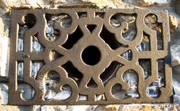 Iron Retro grid in the smoke outlet of a village house stock image