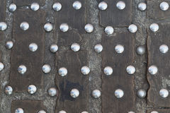 Iron rivets on the stone cobbles Stock Photo