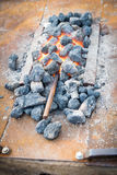 Iron rod put to heat in the hot coals. stock photography
