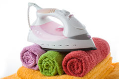 Iron on rolled up towels Royalty Free Stock Photography