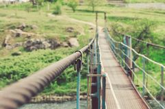The iron rope is stretched. In the air and holds a suspension bridge Royalty Free Stock Photography