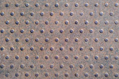 Iron rusty background with dots. Industrial structure royalty free stock image