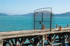 Iron rusty bar gate on pier Stock Photos