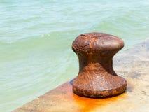 Iron rusty mooring bollard Stock Images