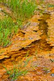 Iron saturated creek in a mining area Stock Photos