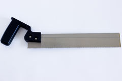 Iron saw on white background. Saw with a black plastic handle on a white background Stock Photography